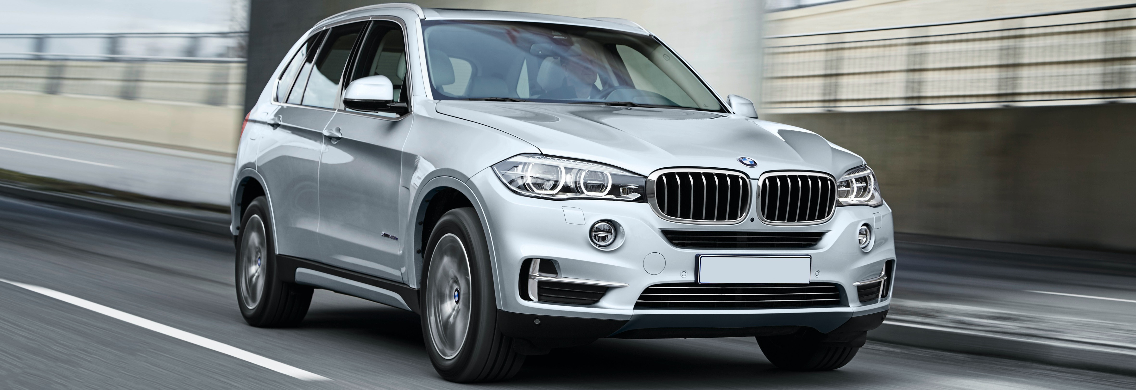 Silver BMW X5 Driving, Viewed From The Front