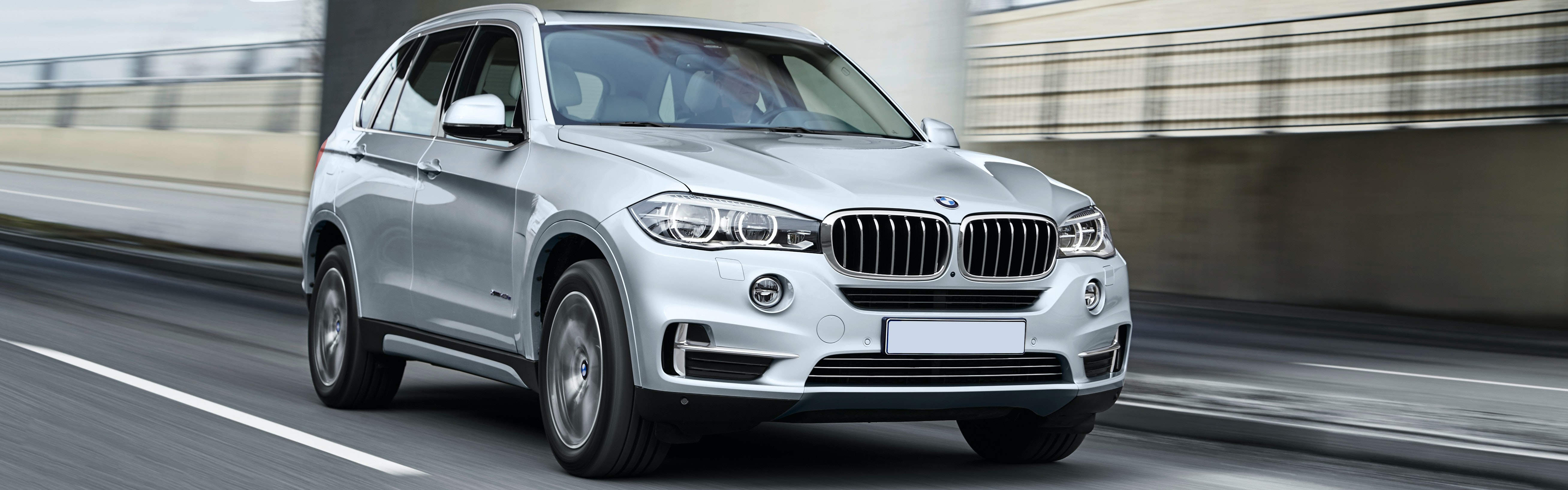 Silver BMW X5 Hybrid Driving, Viewed From The Front