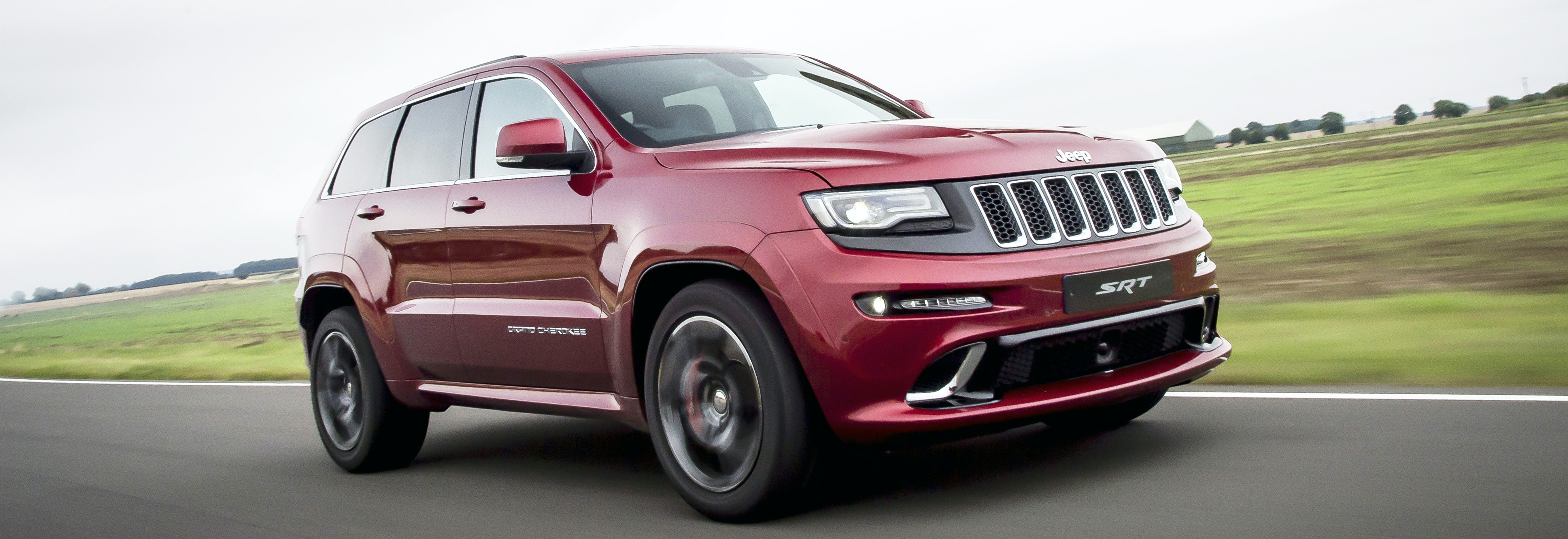 2018 jeep gran cherokee red driving front