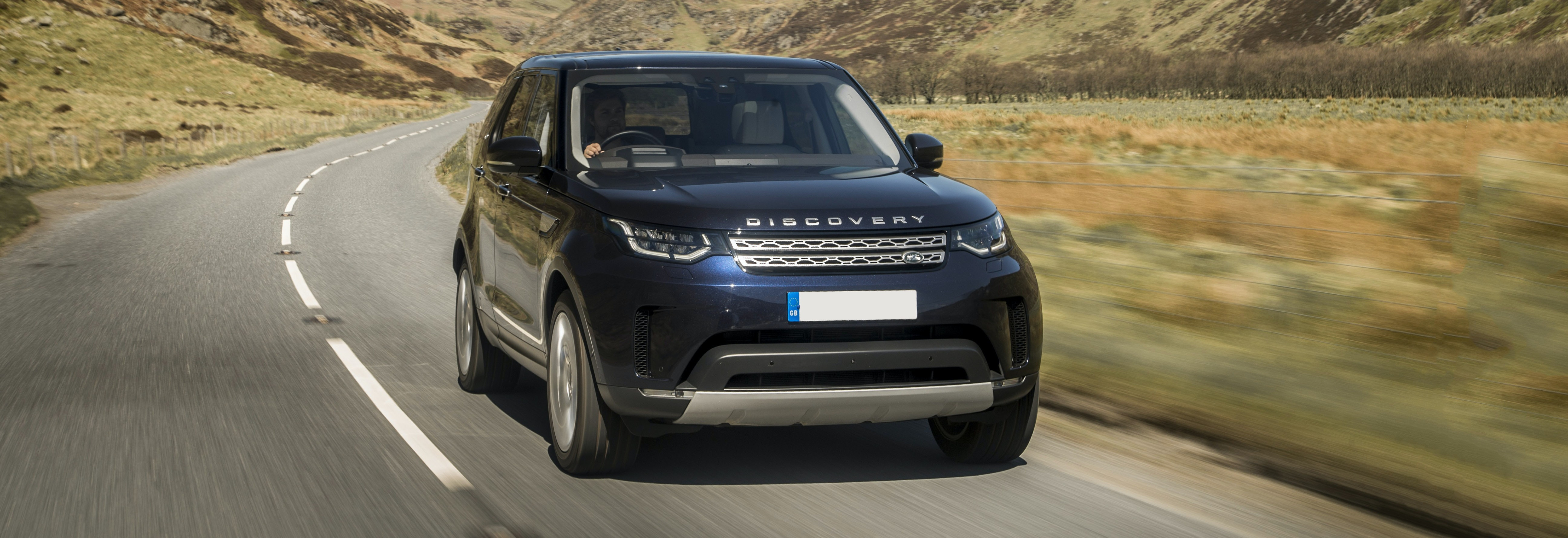2018 land rover discovery blue driving front