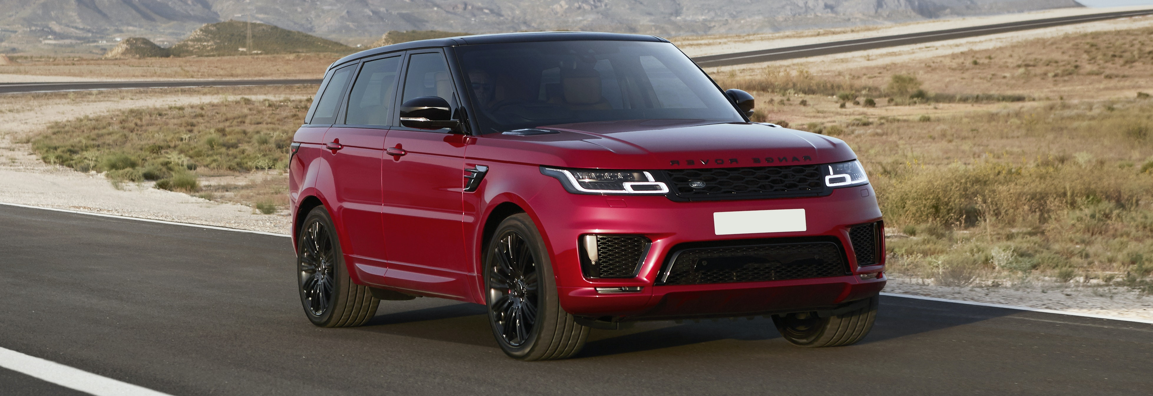 2018 range rover sport red driving front