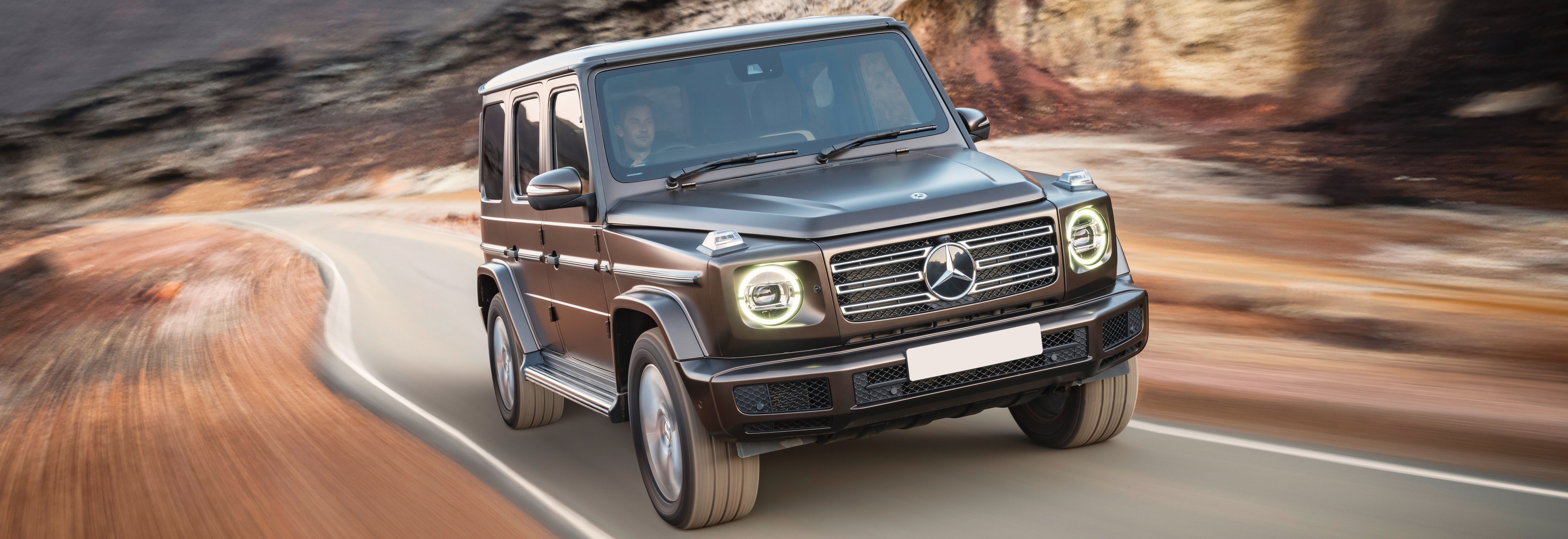 2018 mercedes g class brown driving front