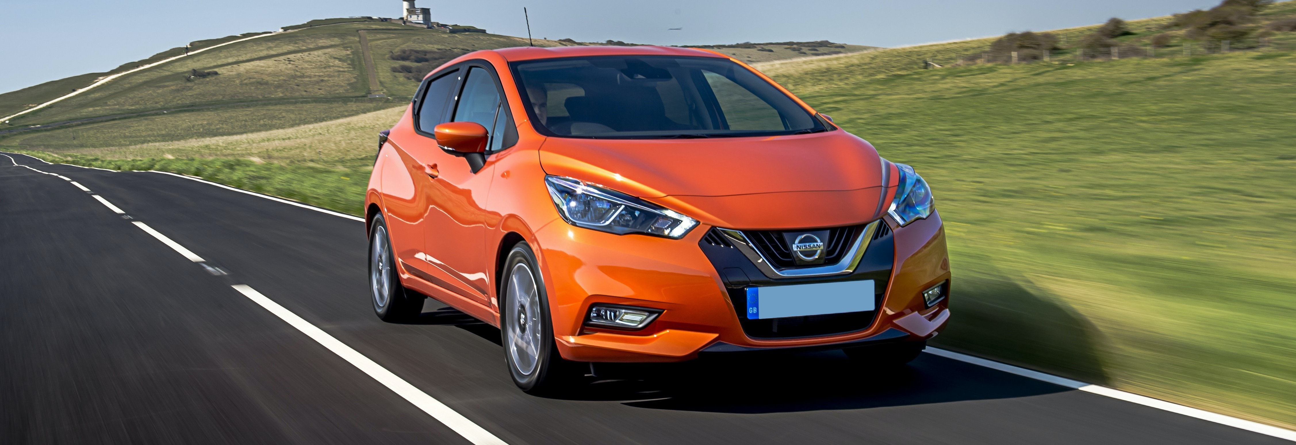 2018 nissan micra orange driving front