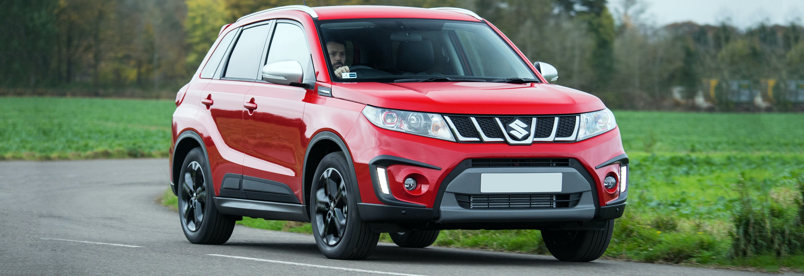 2018 suzuki vitara red driving front cornering