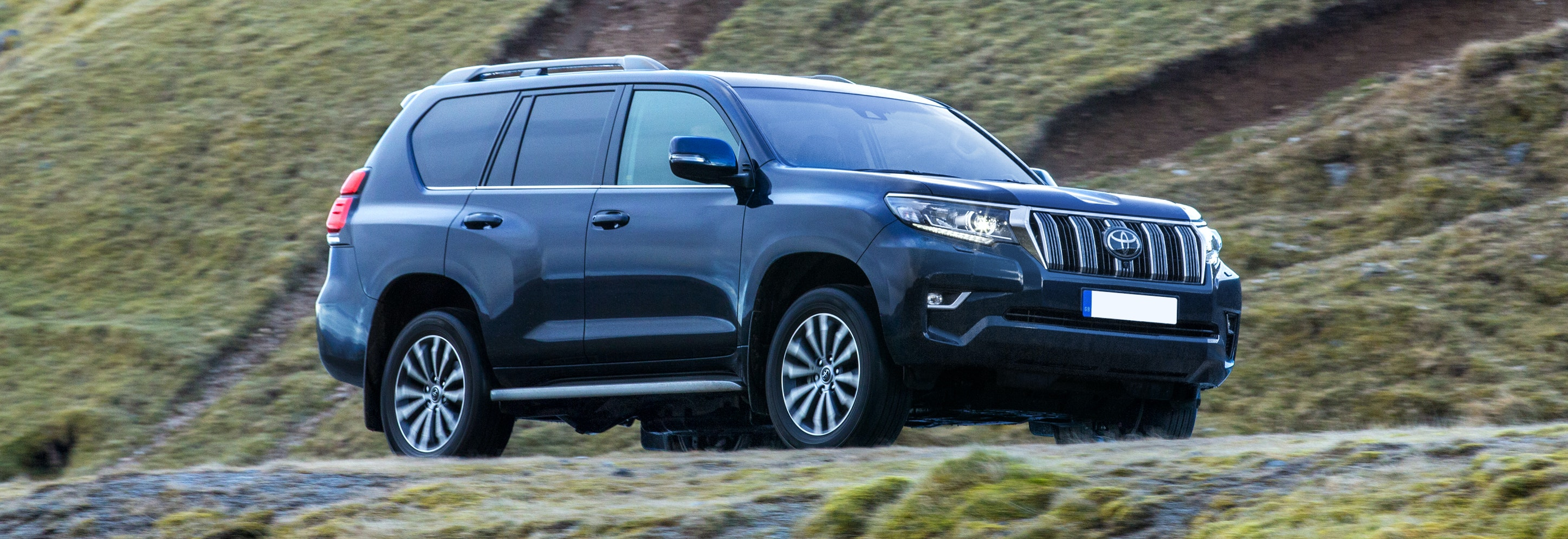 2018 toyota land cruiser blue driving front