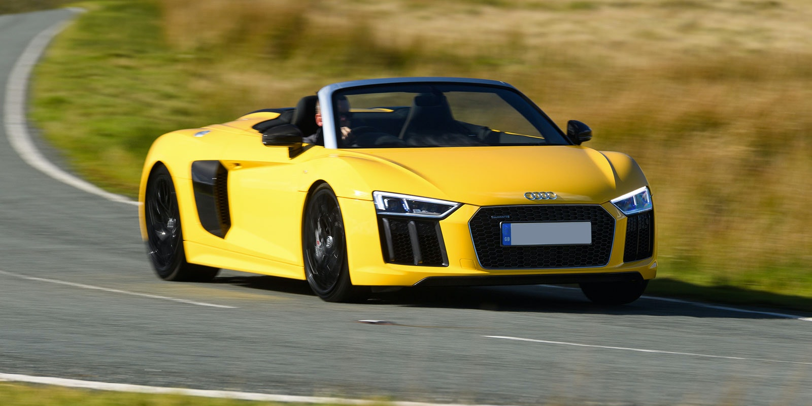 Yellow audi r8 spyder front driving best convertibles lead 1.jpg?ixlib=rb 1.1